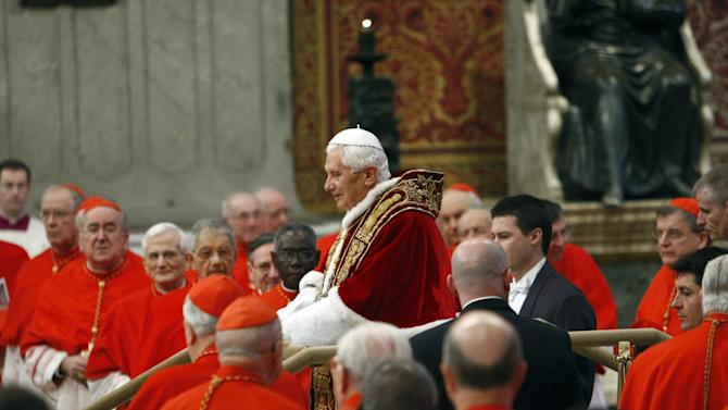 Pope Benedict XVI arrives to preside over a consistory in St. Peter's basilica at the Vatican, Saturday, Feb. 18, 2012. Pope Benedict XVI is bringing 22 new Catholic churchmen into the elite club of cardinals who will elect his successor amid signs the 84-year-old pontiff is slowing down. Benedict was presiding over a ceremony Saturday in St. Peter's Basilica to formally create the 22 cardinals, who include the archbishops of New York, Prague, Hong Kong and Toronto as well as the heads of several Vatican offices. (AP Photo/Andrew Medichini)