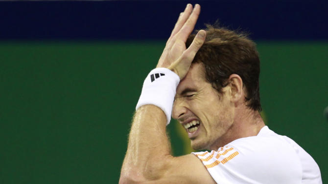 Andy Murray of Britain reacts after missing a point against Novak Djokovic of Serbia during the men's singles final at the Shanghai Masters tennis tournament at Qizhong Forest Sports City Tennis Center in Shanghai, China, Sunday Oct. 14, 2012. (AP Photo/Eugene Hoshiko)