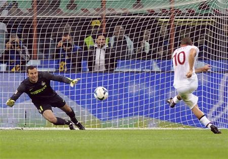 AS Roma's Totti scores his second goal against Inter Milan during their Italian Serie A soccer match in Milan