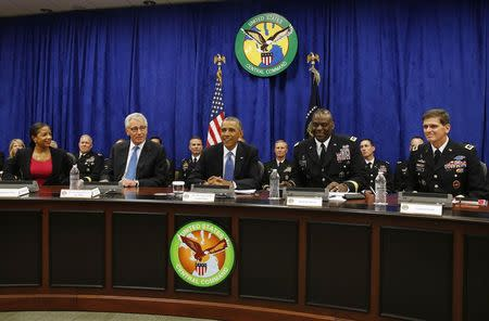 U.S. President Barack Obama participates in a briefing while visiting at U.S. Central Command at MacDill Air Force Base in Tampa