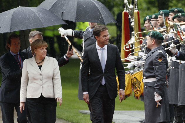 German Chancellor Merkel and Netherlands' PM Rutte review the troops in Kleve