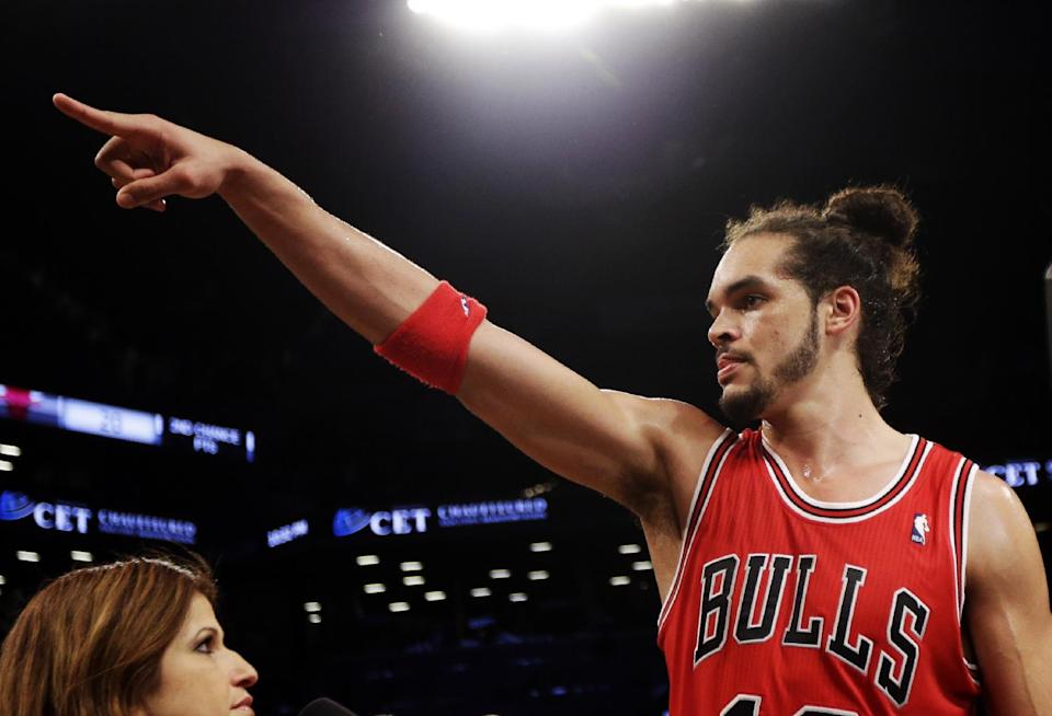 Chicago Bulls' Joakim Noah celebrates with after defeating the Brooklyn Nets 99-93 in Game 7 of their first-round NBA basketball playoff series in New York, Saturday, May 4, 2013. The Bulls won the series to advance to a second-round series against the Miami Heat beginning Monday. (AP Photo/Julio Cortez)