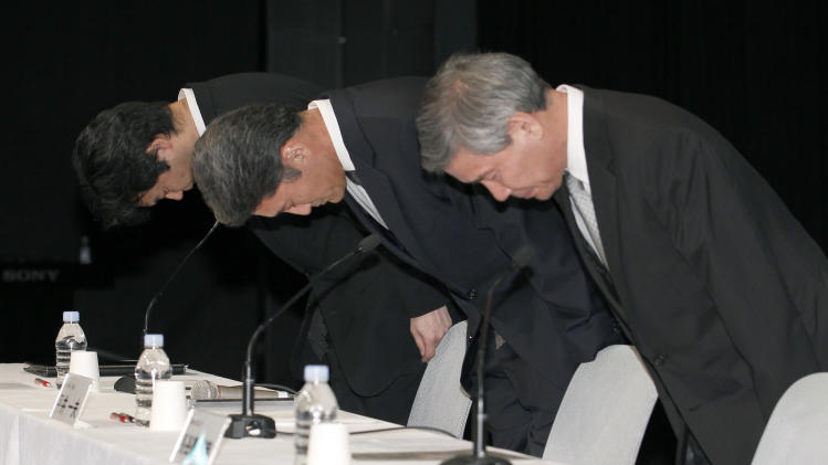 Sony Computer Entertainment President and CEO Kazuo Hirai, center, bows along with two other executives at the start of a press conference at the Sony Corp. headquarters in Tokyo Sunday, May 1, 2011. The three executives bowed in apology for a security breach in the company's PlayStation Network that caused the loss of personal data of some 77 million accounts on the online service. Next to Hirai are Sony Corp.'s Senior Vice Presidents Shiro Kambe, left, and Shinji Hasejima, right. (AP Photo/Shizuo Kambayashi)