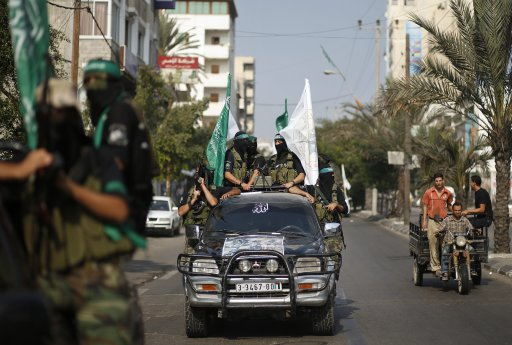 Hamas militants take part in a march in Gaza City