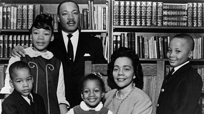 """FILE - This 1966 file photo is the last official portrait taken of the entire King family, made in the study of Ebenezer Baptist Church in Atlanta. From left are Dexter King, Yolanda King, Martin Luther King Jr., Bernice King, Coretta Scott King and Martin Luther King III. In 1963, Martin Luther King Jr. declared, """"I have a dream that my four little children will one day live in a nation where they will not be judged by the color of their skin but by the content of their character."""" (AP Photo/Atlanta Journal-Constitution, File)"""