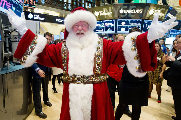In this photo provided by the New York Stock Exchange, a man portraying Santa Claus visits the trading floor of the New York Stock Exchange, Wednesday Nov. 21, 2012 before he participated in opening b