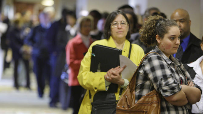 In this May 3, 2011 photo, Samantha Ferrara, 19, waits in line for a job fair to open, in Independence, Ohio. Employers added more than 200,000 jobs in April for the third straight month, the biggest hiring spree in five years. But the unemployment rate rose to 9 percent in part because some people resumed looking for work. (AP Photo/Tony Dejak)