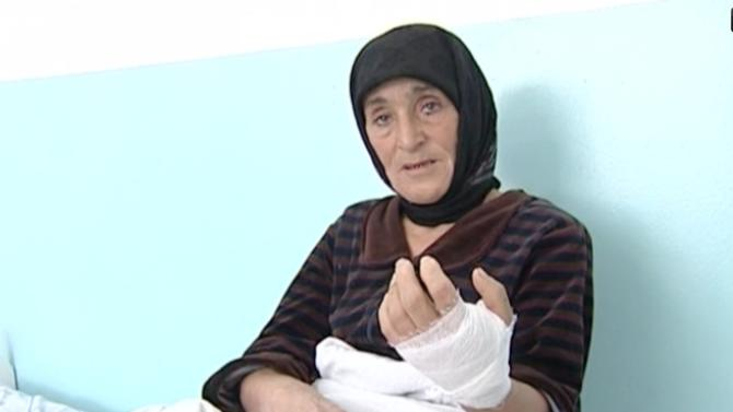 In this video grab provided by the APTN on Tuesday, Nov. 13, 2012 Aishat Maksudova speaks at a hospital, at Kizlyar, Russia Caucasus provivce. The frail 56-year old woman seemed an easy target for a wolf, who attacked her outside her house in Russia's province of Dagestan in the North Caucasus Mountains. The animal bit her by the arm and her leg and she fell to the ground, crying vainly for help without any villagers at sight. And then Aishat Maksudova reached for an ax she brought along to repair a fence. With a remarkable aplomb, she hit the wolf over the head several times until his teeth unclenched.  (AP Photo/ APTN)