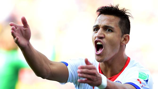 Chile's forward Alexis Sanchez reacts during a Group B football match between Netherlands and Chile at the Corinthians Arena in Sao Paulo during the 2014 FIFA World Cup on June 23, 2014