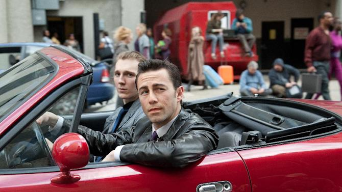"This film image released by Sony Pictures shows Joseph Gordon-Levitt, foreground, and Paul Dano in a scene from the action thriller ""Looper."" (AP Photo/Sony Pictures Entertainment, Alan Markfield)"