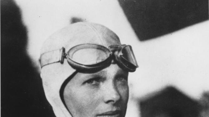 FILE - This undated file photo shows Amelia Earhart. Three bone fragments found on a South Pacific island could help prove that Earhart died as a castaway after failing in her quest to circumnavigate the globe.  Researchers told The Associated Press on Friday Dec. 17, 2010 that the University of Oklahoma hopes to extract DNA from bones found by a Delaware group dedicated to the recovery of historic aircraft. The fragments were recovered earlier this year on an uninhabited island about 1,800 miles south of Hawaii. (AP Photo/File)