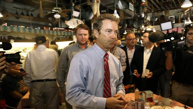 Sen. Rand Paul, R-Ky., mingles during a meet and greet along with North Carolina Republican Senatorial candidate Thom Tillis, not shown, at Big Ed's City Market in Raleigh, N.C., Wednesday, Oct. 1, 2014. Paul is helping North Carolina Republican Senate candidate Thom Tillis even after supporting Tillis' chief rival in the GOP primary. (AP Photo/Gerry Broome)