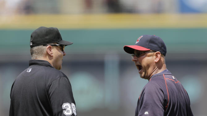 Cleveland Indians manager Terry Francona, right, argues with third base coach Gary Cederstrom after Francona was ejected by home plate umpire Tom Woodring in the fifth inning of a baseball game against the Kansas City Royals, Wednesday, July 29, 2015, in Cleveland. (AP Photo/Tony Dejak)
