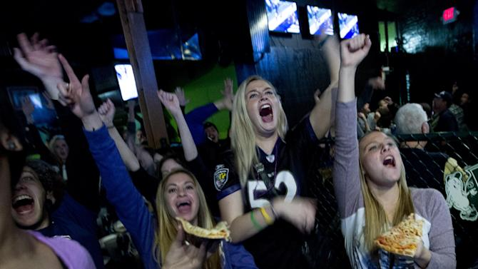 Baltimore Ravens fans celebrates after their team scored the first touchdown against San Francisco 49ers, at local pub in Baltimore on Sunday Feb. 3, 2013. (AP Photo/Jose Luis Magana)
