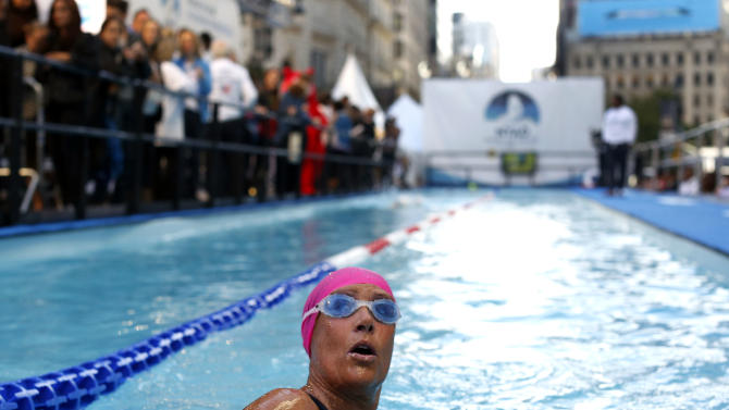 "Long-distance swimmer Diana Nyad, who recently completed a record-breaking swim from Cuba to Florida, completes a lap during a continuous 48-hour marathon swim event in New York's Herald Square called ""Swim for Relief,"" which aims to raise funds and awareness for Hurricane Sandy recovery efforts, Tuesday, Oct. 8, 2013. (AP Photo/Jason DeCrow)"