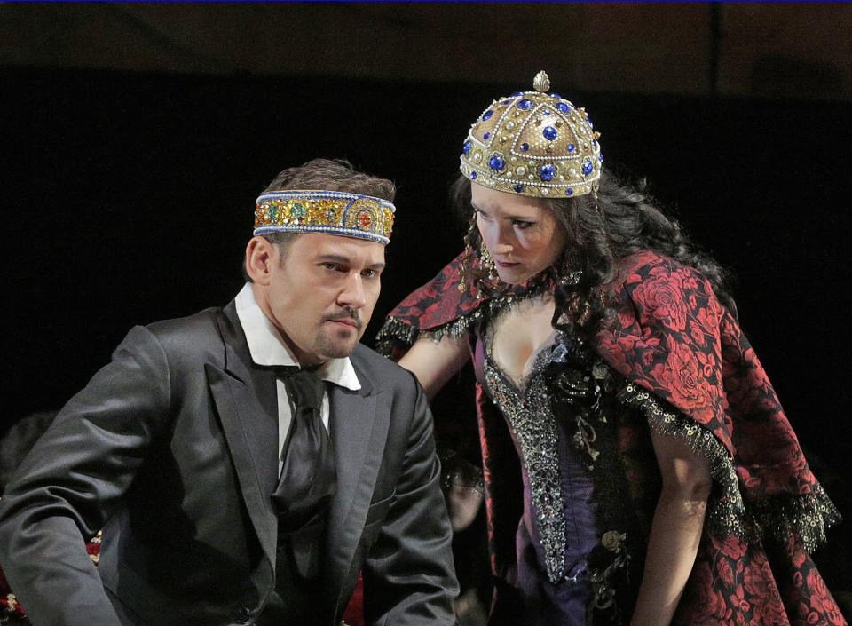 "In this undated photo provided by the Santa Fe Opera, Mariusz Kwiecien, left, and Erin Morley perform in the Santa Fe Opera production of Polish composer Karol Szymanowski's ""King Roger."" (AP Photo/Santa Fe Opera, Ken Howard)"