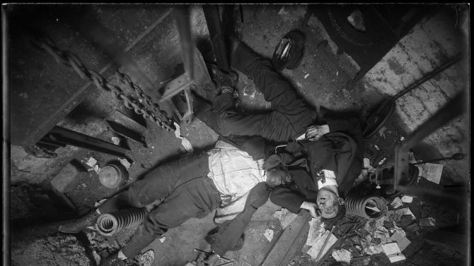In this Nov 24, 1915 photo provided by the New York City Municipal Archives, the bodies of elevator operator Robert Green, left and Jacob Jagendorf, a building engineer, lie at the bottom of an elevator shaft in New York. Over 870,000 photos from an archive that exceeds 2.2 million images have been scanned and made available online, for the first time giving a global audience a view of a rich collection that documents life and sometimes death in New York City. (AP Photo/New York City Municipal Archives, NYPD Evidence Collection) MANDATORY CREDIT