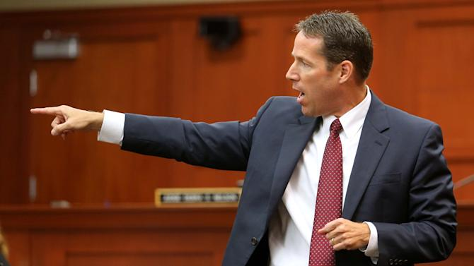 Assistant State Attorney John Guy points out defendant George Zimmerman during the state's opening argument in front of the jury in the Zimmerman trial, in Seminole circuit court, in Sanford, Fla., Monday, June 24, 2013. Zimmerman has been charged with second-degree murder for the 2012 shooting death of Trayvon Martin. (AP Photo/Orlando Sentinel, Joe Burbank,Pool)