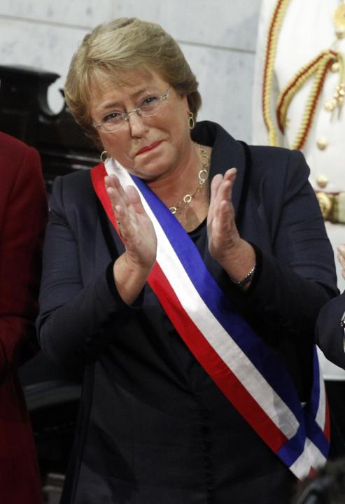 Chile's President Michelle Bachelet applauds after she was sworn in to office in Valparaiso