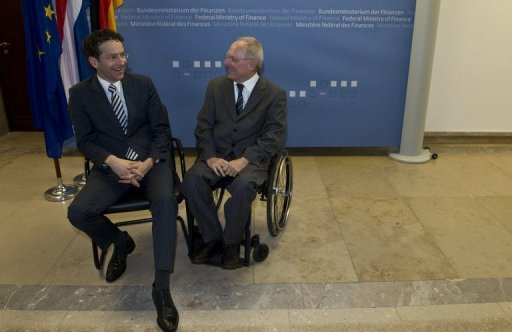 &lt;p&gt;German Finance Minister Wolfgang Schaeuble (right) chats with his Dutch counterpart Jeroen Dijsselbloem in Berlin on December 17, 2012. Schaeuble warned Britain in a Sunday newspaper interview against &quot;blackmailing&quot; its EU partners in a bid to bring powers back home from Brussels.&lt;/p&gt;
