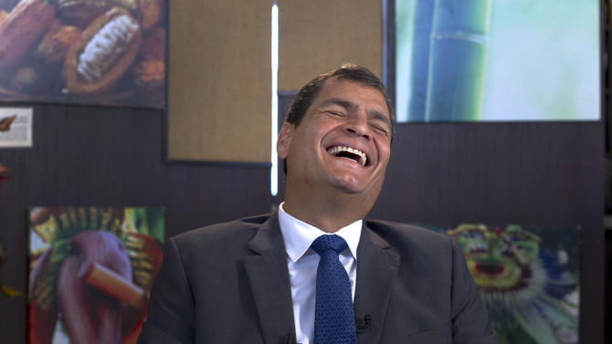 """Ecuador's President Rafael Correa, laughs during a interview with The Associated Press in Portoviejo, Ecuador, Sunday, June 30, 2013. Correa said he had no idea Snowden's intended destination was Ecuador when he fled Hong Kong for Russia last week. He said the Ecuadorean consul in London committed """"a serious error"""" without consulting any officials in the capital, Quito, when the consul issued a letter of safe passage for Snowden.(AP Photo/Martin Mejia)"""
