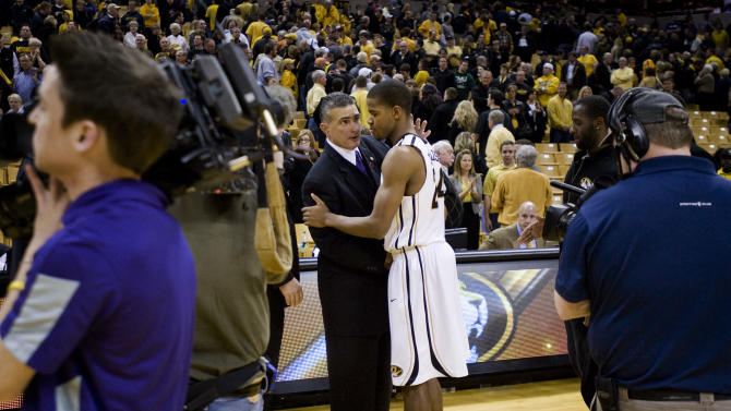 Missouri's Kim English, right, is consoled by Kansas State coach Frank Martin after Kansas State defeated Missouri 78-68 in an NCAA college basketball game Tuesday, Feb. 21, 2012, in Columbia, Mo. (AP Photo/L.G. Patterson)