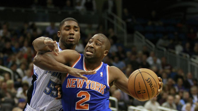 New York Knicks' Raymond Felton (2) drives past Orlando Magic's E'Twaun Moore (55) during the first half of an NBA basketball game, Tuesday, Nov. 13, 2012, in Orlando, Fla. (AP Photo/John Raoux)