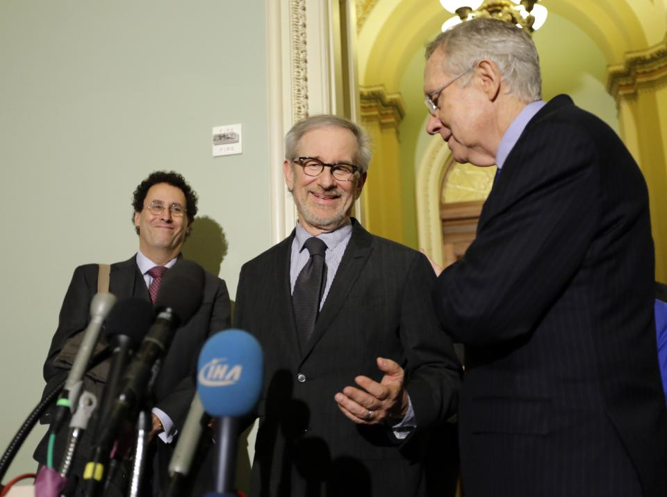 "Writer Tony Kushner, left, director Steven Spielberg, and Senate Majority Leader Harry Reid of Nevada, pause during a media availability before a screening of the movie ""Lincoln,"" for members of Congress, on Capitol Hill, Wednesday, Dec. 19, 2012 in Washington. (AP Photo/Alex Brandon)"
