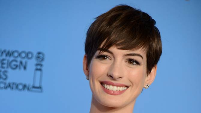 """Anne Hathaway poses with the award for best performance by an actress in a supporting role in a motion picture in """"Les Miserables"""" backstage at the 70th Annual Golden Globe Awards at the Beverly Hilton Hotel on Sunday Jan. 13, 2013, in Beverly Hills, Calif. (Photo by Jordan Strauss/Invision/AP)"""