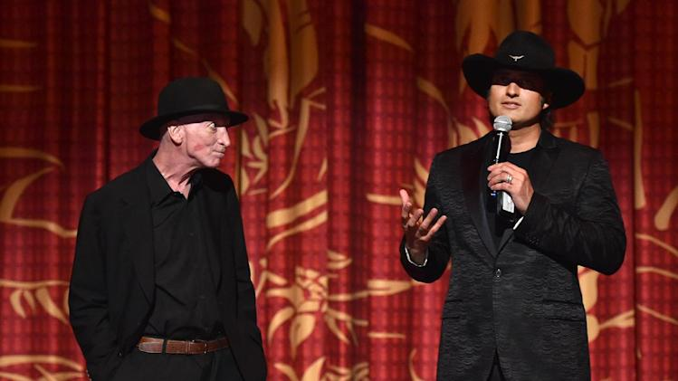"Writer/director Frank Miller, left, and director Robert Rodriguez speak on stage at the ""Sin City: A Dame to Kill For"" premiere presented by Dimension Films in partnership with Time Warner Cable, Dodge and DeLeon Tequila at TCL Chinese Theatre on Tuesday, August 19, 2014, in Los Angeles. (Photo by John Shearer/Invision for The Weinstein Company/AP Images)"