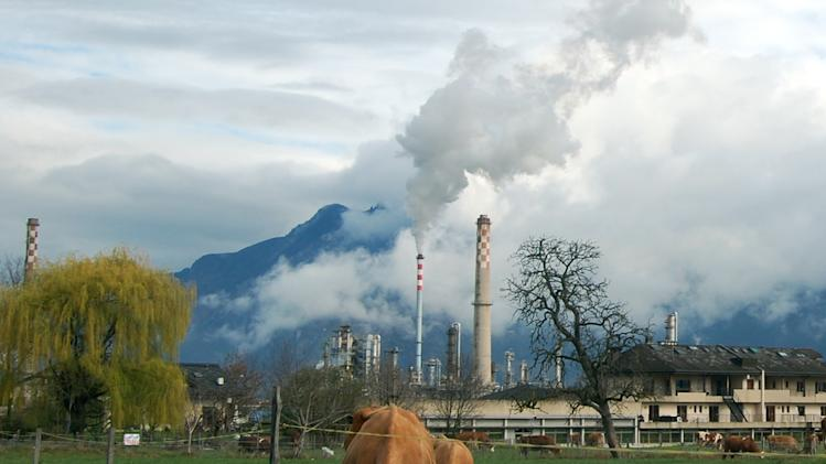 Smoke rises from the Libyan-owned Tamoil oil refinery in Collombey-Muraz, on Wednesday, March 30, 2011, on the eastern tip of Lake Geneva, Switzerland. The refinery is evidence of Libyan leader Moammar Gadhafi's strong foothold in Europe, as Tamoil has been allowed to continue operating unchecked despite the fact that its parent company is on a United Nations sanctions list and some experts including Zurich-based money-laundering expert Michael Alkalay, say European governments are being naive, or simply self-serving, in an attempt to protect European jobs and oil supplies. (AP Photo/Frank Jordans)