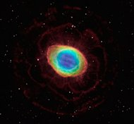 In this composite image, visible-light observations by NASA's Hubble Space Telescope are combined with infrared data from the ground-based Large Binocular Telescope in Arizona to assemble a dramatic view of the well-known Ring Nebula. Called a