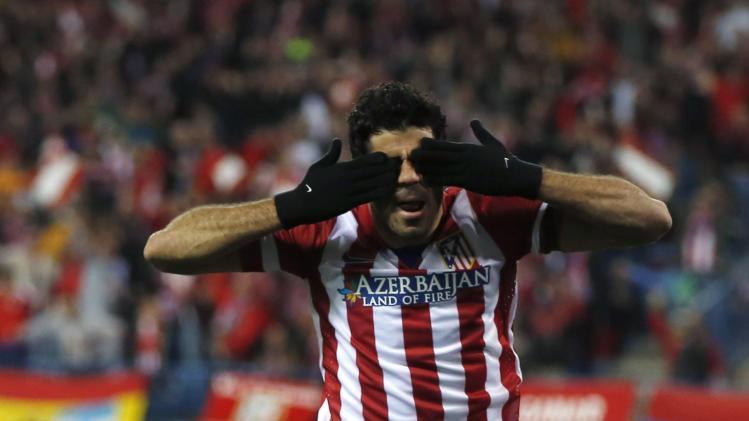 Atletico Madrid's Diego Costa celebrates scoring a goal against AC Milan during their Champions League last 16 second leg soccer match at Vicente Calderon stadium