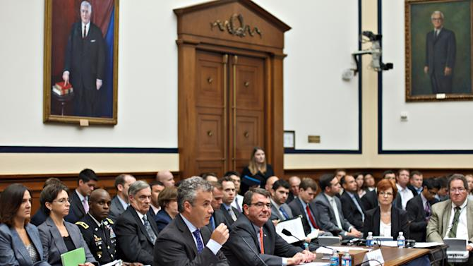 Acting Budget Director Jeffrey Zients, with Deputy Secretary of Defense Ashton Carter, right, testifies on Capitol Hill in Washington, Wednesday, Aug. 1, 2012, before the House Armed Services Committee hearing on defense cuts.  (AP Photo/J. Scott Applewhite)