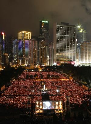 Tens of thousands of people attend a candlelight vigil at Hong Kong's Victoria Park Saturday, June 4, 2011, to mark the 22nd anniversary of the June 4th Chinese military crackdown on the pro-democracy movement in Beijing.  (AP Photo/Kin Cheung)