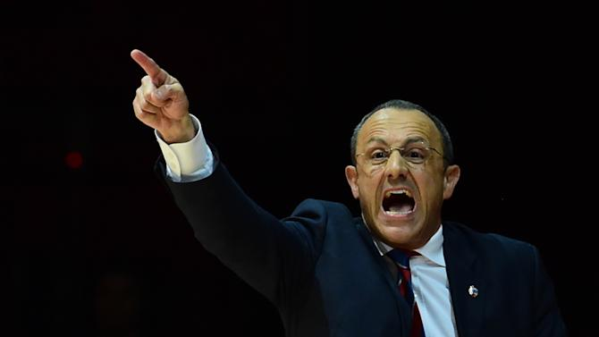 Coach Ettore Messina gestures during a basketball match in Assago, Italy, on May 16, 2014