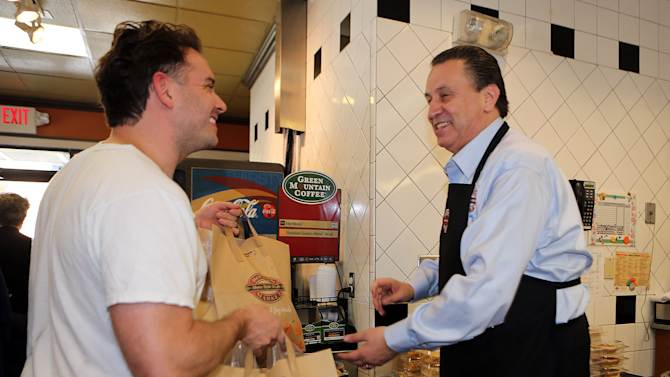 IMAGE DISTRIBUTED FOR BOSTON MARKET - Boston Market CEO George Michel works inside the company's Miami-area restaurants, the home style restaurant chains busiest day of the year, on Thursday, Nov. 22, 2012 in Miami. (Photo by Marc Serota/Invision for Boston Market/AP Images)