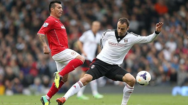 Cardiff City's Gary Medel challenges Dimitar Berbatov of Fulham (PA Photos)