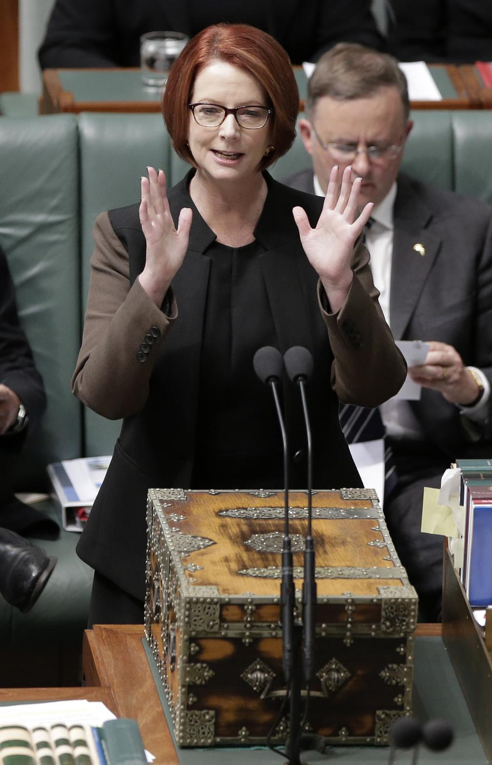 Australian Prime Minister Julia Gillard speaks in the parliament in Canberra, Australia, Wednesday, June 26, 2013. Supporters of Gillard's chief intra-party rival are again pushing for a vote to oust the Australian prime minister this week. (AP Photo/Rick Rycroft)