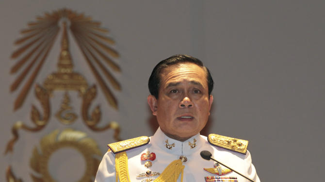 Gen. Prayuth Chan-ocha speaks at the start of his first press conference since Thursday's coup Monday, May 26 , 2014. Thailand's coup leader said Monday that the country's king had officially endorsed him to run the nation after the armed forces seized power last week. The announcement came one day after the junta warned protesters it was ready to crackdown on civilian opposition to its takeover. (AP Photo/Sakchai Lalit)