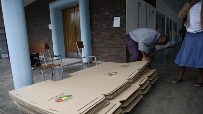 Workers from the Zimbabwe Electoral Commission  sort  material for use as polling booths in  Harare, Thursday, March, 14, 2013. The country is set to hold  a referendum  on Saturday  in  which people are expected to vote  for the adoption of the  draft constitution as the country prepares to hold elections  later in the year. (AP Photo/Tsvangirayi Mukwazhi)