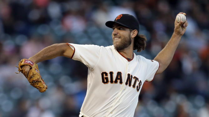 San Francisco Giants' Madison Bumgarner works against the Colorado Rockies in the first inning of a baseball game Tuesday, Aug. 26, 2014, in San Francisco. (AP Photo/Ben Margot)