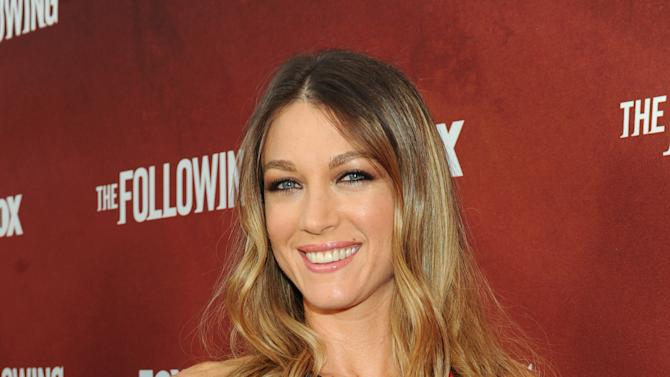 """Actor Natalie Zea arrives at FOX's """"The Following"""" finale screening at the Academy of Television Arts & Sciences' Leonard H. Goldenson Theater on Monday, April 29, 2013 in North Hollywood, California. (Photo by Frank Micelotta/Invision for FOX/AP Images)"""