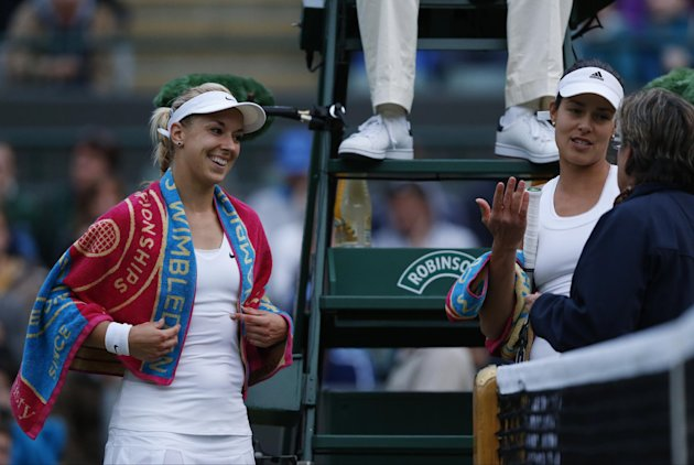 Sabine Lisicki of Germany and Ana Ivanovic of Serbia talk to officials during fading light at Wimbledon Saturday night. They'll resume Monday on Court...