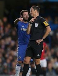 Mark Clattenburg, right, is understood to be determined to clear his name