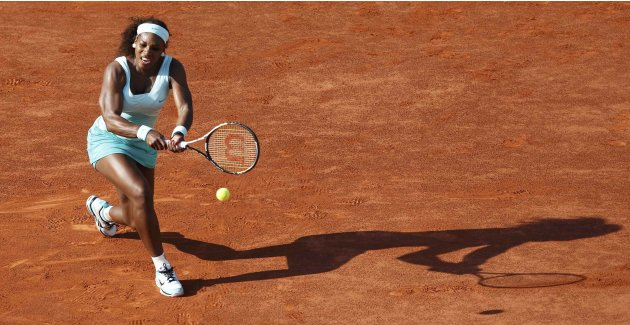 Serena Williams of the U.S. returns the ball to Virginie Razzano of France during the French Open tennis tournament at the Roland Garros stadium in Paris