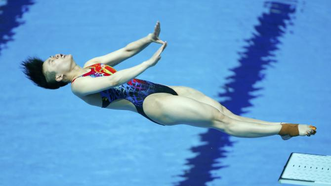 Shi of China jumps during the women's 3m springboard semi-final at the Aquatics World Championships in Kazan