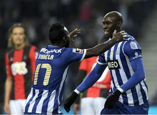 FC Porto's Eliaquim Mangala, from France, celebrates with Silvestre Varela, left, after scoring the opening goal against Olhanense in a Portuguese League soccer match at the Dragao Stadium in Port