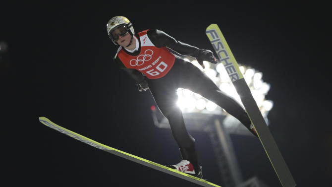 Austria's Thomas Morgenstern makes an attempt in the men's normal hill ski jumping training at the 2014 Winter Olympics, Thursday, Feb. 6, 2014, in Krasnaya Polyana, Russia. (AP Photo/Matthias Schrader)