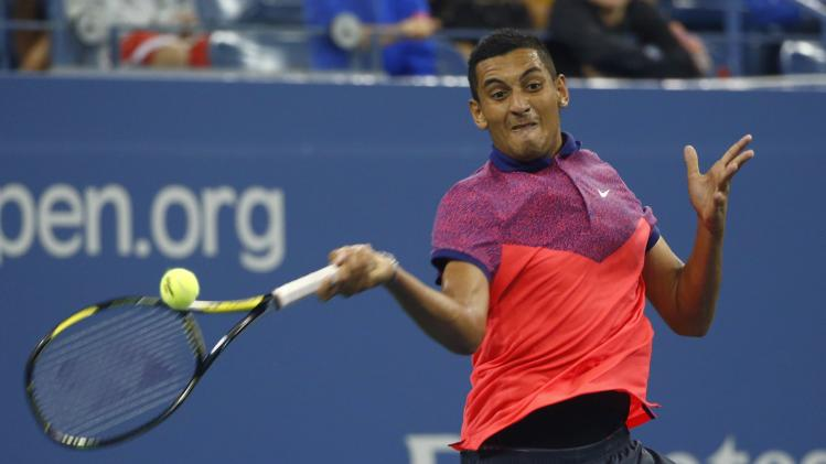 Nick Kyrgios of Australia returns a shot to Tommy Robredo of Spain during their men's singles match at the 2014 U.S. Open tennis tournament in New York